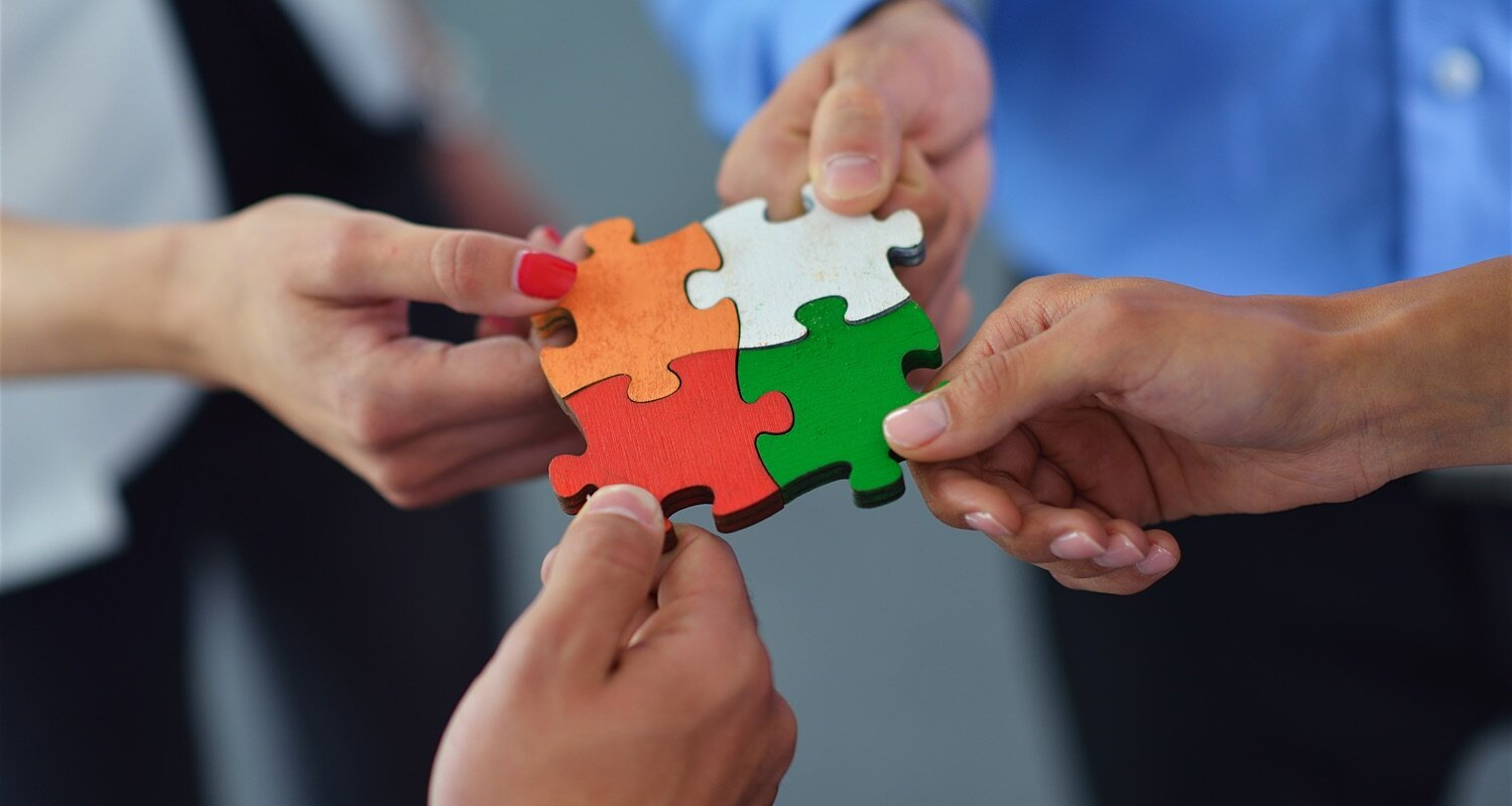bigstock-group-with-puzzle-pieces